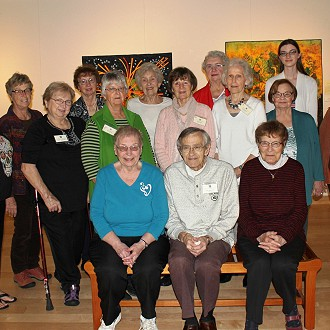 Gallery Docents and Docent Coordinator Kristia.  Would you like to volunteer in Gallery 110 North?  Please contact us today!