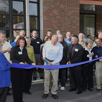 Ribbon Cutting President Tom Slater and Executive Director Donna Hahn with the Sheboygan County Chamber of Commerce